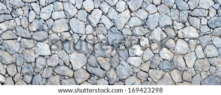 Panorama of stone wall background and texture  - stock photo