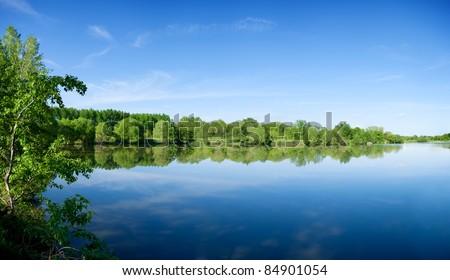 Panorama of summer morning lake - stock photo
