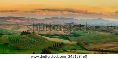 Panorama of sunset at Tuscany field, Italy