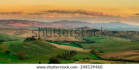 Panorama of sunset at Tuscany field, Italy - stock photo