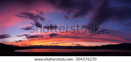 Panorama of sunset on Tuzkol lake in Tian Shan mountain, Kazakhstan