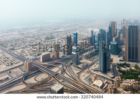 Panorama of tall Skyscrapers in skyline of Emirates against blue sky. - stock photo