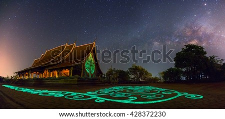 Panorama of Temple Sirindhorn Wararam Phuproud in Ubon Ratchathani Province at night and The Milky Way, The public temple of buddhism. no restrict in copy or use - stock photo