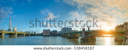 Panorama of Thames river on sunset with Sun setting over Southwark bridge