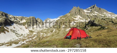 Panorama of the Alps in canton Uri, Switzerland, with a tent. - stock photo