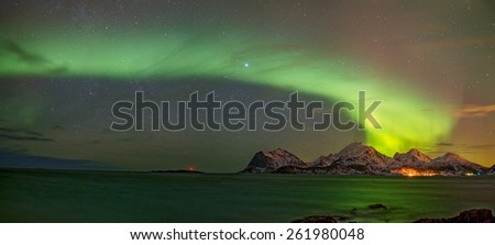 Panorama of the Aurora borealis (Polar lights) over the mountains in the North of Europe - Lofoten islands, Norway - stock photo