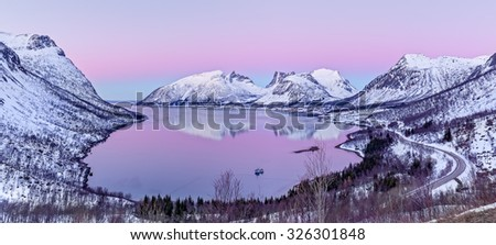 Panorama of the beautiful fjord on Senja island at sunset, Troms county - Norway - stock photo