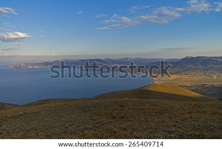 Panorama of the Black Sea coast. Crimea, view from the slope of Cape Meganom. Morning. - stock photo