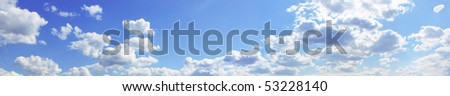 Panorama of the blue cloudy sky - stock photo