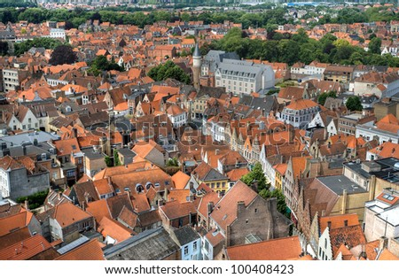 Panorama of the central part of Bruges. Top view on the background of the red roofs of the city. Belgium