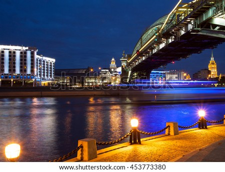 panorama of the city at night from the Bridge of Bogdan Khmelnitsky and the Moscow River in the area of the Kiev station. Moscow, Russia - stock photo