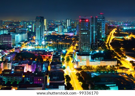 Panorama of the city at night, with low houses and high-rise business centers in the artificial lighting of streets (Night view of Singapore city - downtown) - stock photo