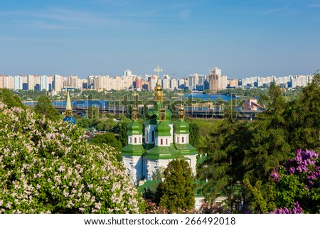 Panorama of the city of Kiev. Ukraine. View of the monastery Vydubitsky, left bank of the Dnieper River and the modern part of town. Kyiv. - stock photo