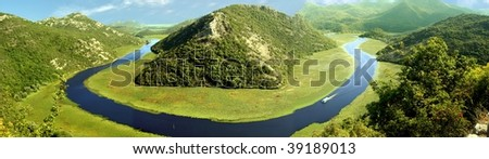 "Panorama of The Crnojevic River in the National park ""Skadarsko lake"", Montenegro. - stock photo"