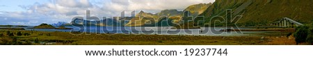 Panorama of the fjord with long modern bridge - stock photo