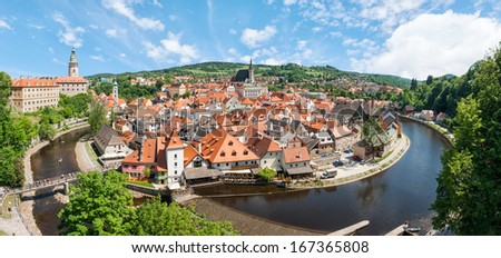 Panorama of the historical part of Cesky Krumlov with Castle and Church of St. Vitius, Czech Republic - stock photo