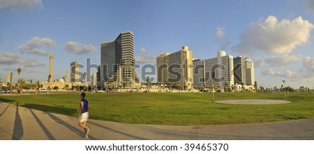 Panorama of The Hotels on Tel-Aviv beach and Jogging man