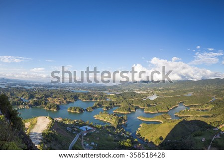 Panorama of the lakes and islands in Guatape taken from Piedra el Penol with blue sky, near Medellin, Colombia. - stock photo