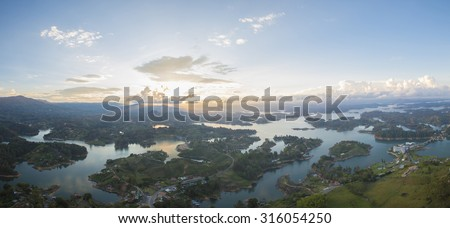Panorama of the lakes and islands in Guatape taken from Piedra el Penol with sunset clear sky, near Medellin, Colombia. - stock photo