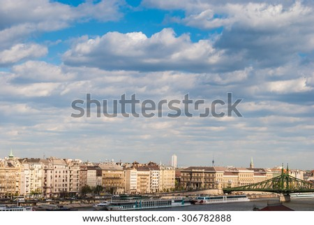 Panorama of the left bank of Danube river in Budapest, Hungary. Beautiful cityscape with houses and clouds. - stock photo