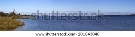 Panorama of the Leschenault estuary near Bunbury western Australia on a late morning in early winter. - stock photo