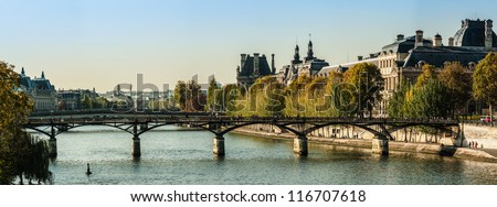 Panorama of the Louvre museum and the bridge of arts in autumn - stock photo