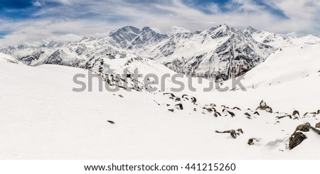 Panorama of the main Caucasus ridge and peak Terskol with Observatory in the foreground - stock photo