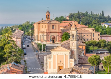Panorama of the medieval village of Longiano in the Romagna hills near Cesena in Italy, with its ancient buildings and churches and the sea in the distance on the horizon