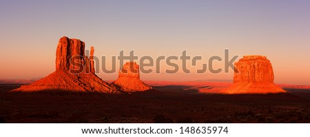 Panorama of the Mitten Buttes of Monument Valley at sunset, Utah, USA - stock photo