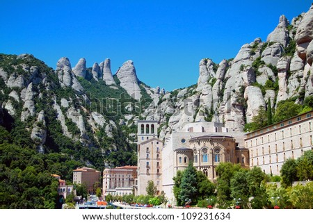 Panorama of the Monastery de Montserrat against background of mountains (Spain) - stock photo
