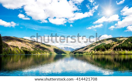 Panorama of the mountain lake - stock photo