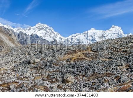 Panorama of the ridge Mahalangur Himal with Cho Oyu peak (8201 m). View from Thopak Tsho (4990 m) - Gokyo region, Nepal, Himalayas - stock photo