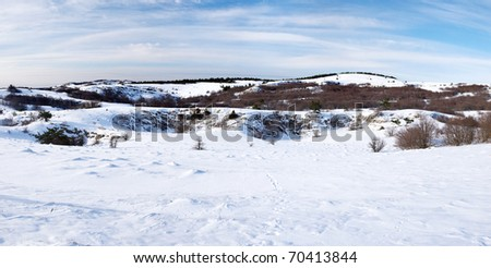 Panorama of the snow declivity on background blue sky