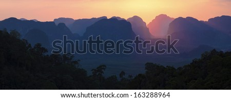 Panorama of the sunset in beauty mountains