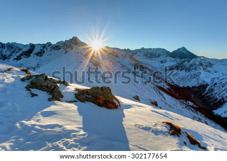 Panorama of thewinter Tatra Mountains with interesting shape of the frozen snow. Silent Valley in Western Tatra Mountains. - stock photo