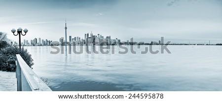 Panorama of Toronto City reflected on the lake. - stock photo
