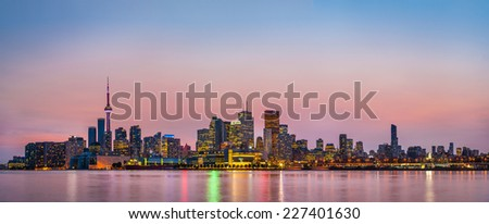 Panorama of Toronto over Ontario Lake at dusk