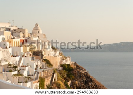 Panorama of traditional terraced houses in Fira, Santorini - stock photo