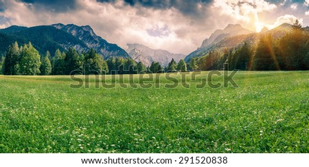 Panorama of Triglav mountain range. Cloudy summer day in the mountain valley, Julian Alps, Slovenia. - stock photo