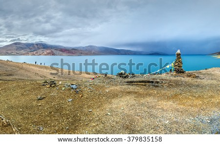 Panorama of Tso the Moriri lake near Karzok village in Rupshu valley against the background of cloudly sky - Tibet, Leh district, Ladakh, Himalayas, Jammu and Kashmir, Northern India. - stock photo