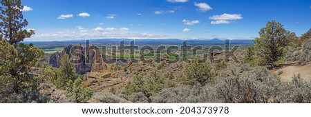Panorama of valley floor of the Crooked River  near Smith Rock State Park, Central Oregon. - stock photo