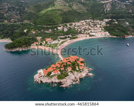 Panorama of Villa Milocer (Aman Resorts) on the Sveti Stefan rocky island and luxury beaches. Aerial view from Adriatic sea. Montenegro