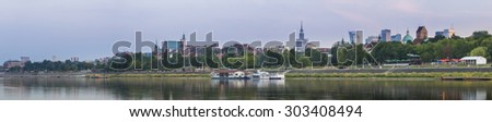 Panorama of Warsaw city during dusk time - stock photo
