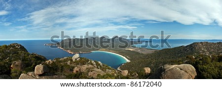 Panorama of Wineglass Bay from summit of Mt Amos, Tasmania, Australia - stock photo