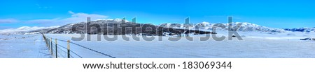 Panorama of winter landscape with farm in Idaho.