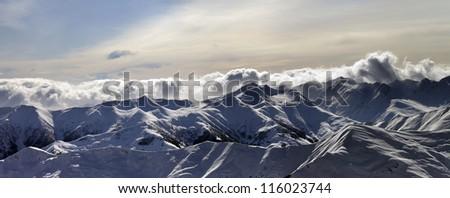 Panorama of winter mountains at sunset. Caucasus Mountains, Georgia, Gudauri. - stock photo