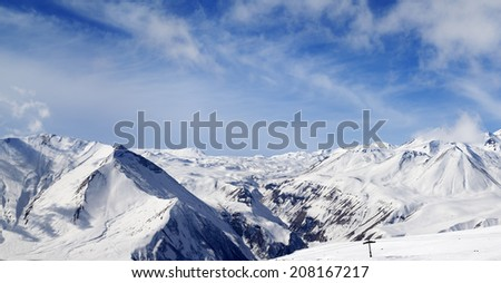Panorama of winter snowy mountains at nice day. Caucasus Mountains, Georgia. Ski resort, Gudauri.
