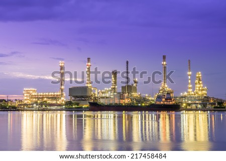 Panorama Oil refinery along the river at Dusk (Bangkok, Thailand) - stock photo