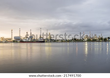 Panorama Oil refinery along the river at Dusk before sunrise (Bangkok, Thailand)