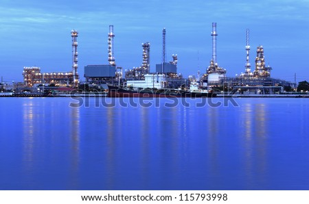panorama on liquid and natural petroleum gas refinery plant area with big ship at twilight, Bangkok, Thailand.